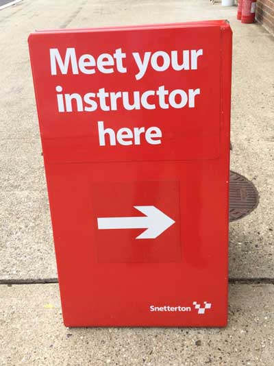 Meet your instructor sign at a race circuit